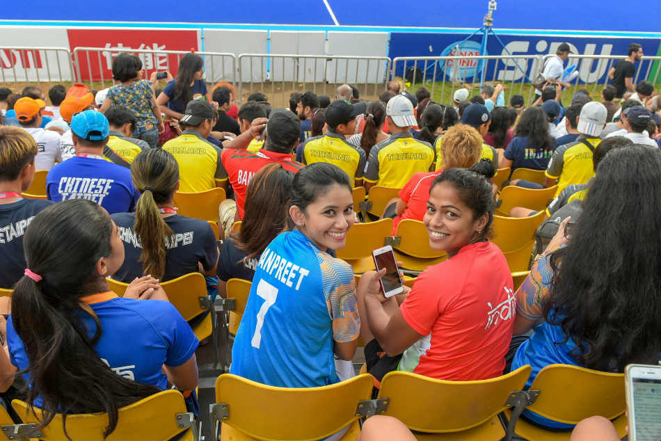 Indian womens hockey team players cheer for the men during the bronze medal playoff against Pakistan at the Asian Games 2018