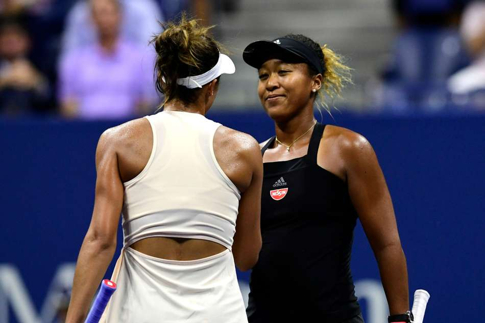 Madison Keys congratulates Naomi Osaka (right) after the match