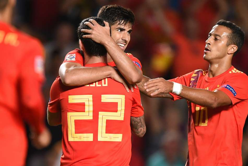 Spains Marco Asensio (centre) celebrates with team-mates Isco and Thiago