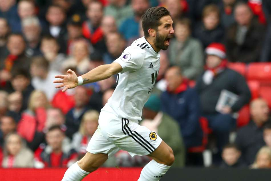 Joao Moutinho celebrates after scoring the equaliser against Manchester United