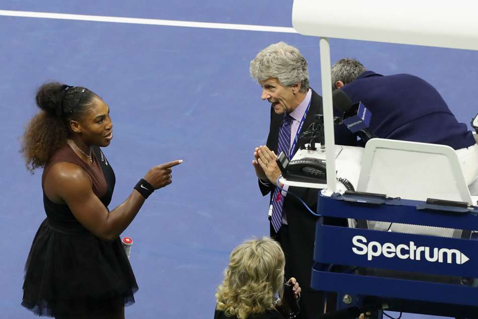 Serena Williams (left) argues with US Open officials