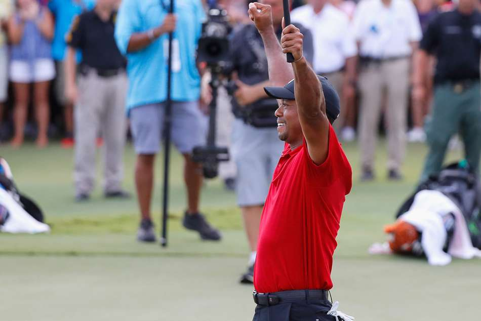 Tiger Woods celebrates first title win since 2013