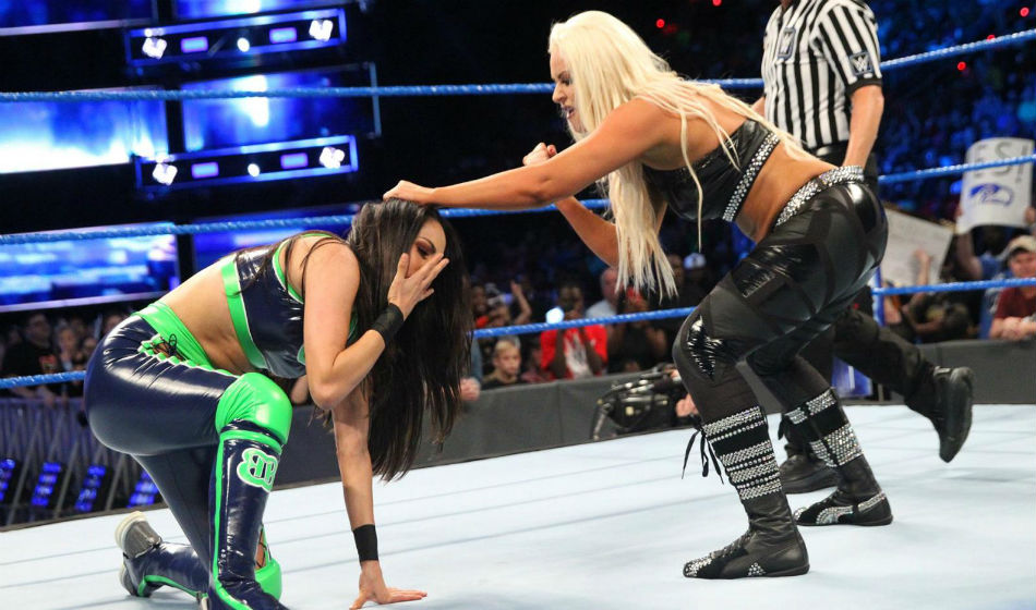 Brie Bella (left) & Maryse in action on Smackdown (image courtesy WWE.com)