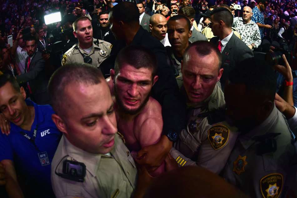 Khabib escorted out after melee