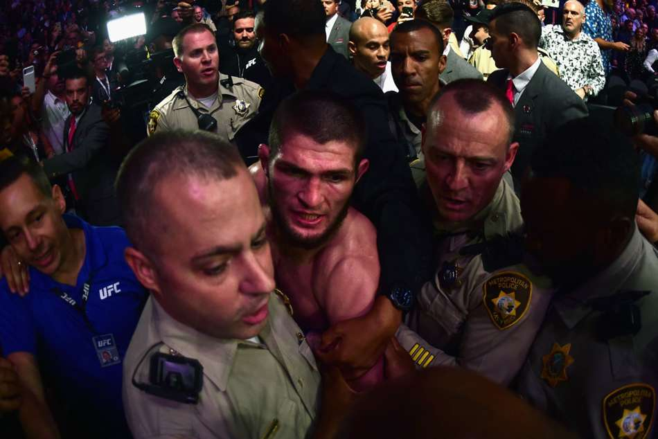Khabib Nurmagomedov escorted by security after UFC 229 main event