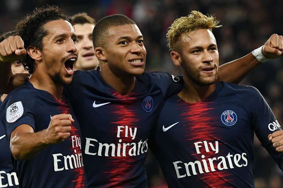 PSG star Kylian Mbappe (centre) celebrates with teammates during win over Lyon