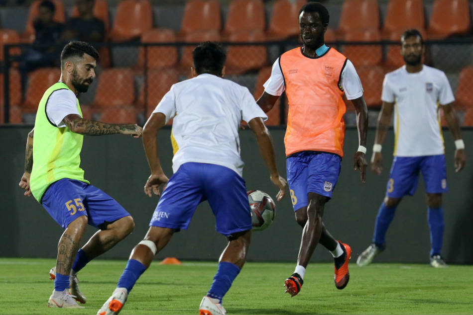 Mumbai City FC players warming up during a training session. Credit: ISL Media