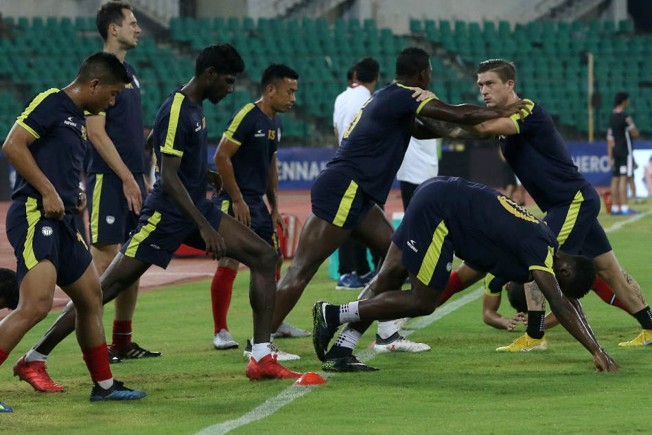NorthEast United FC players warm up during a training session. Credit: ISL Media