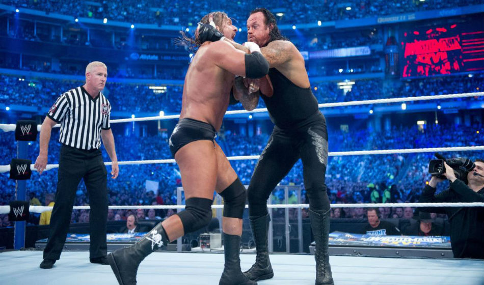 Undertaker (right) and Triple H have fought seventeen times in the WWE (Image Courtesy: WWE)