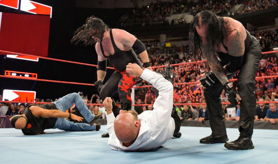 Undertaker (right) and Kane attack Shawn Michaels and Triple on Raw (Image Courtesy: WWE.com)