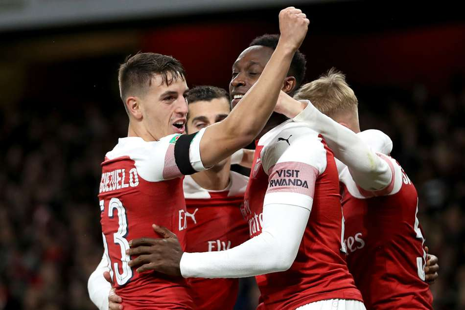 Arsenal players celebrate during their narrow 2-1 victory over Blackpool