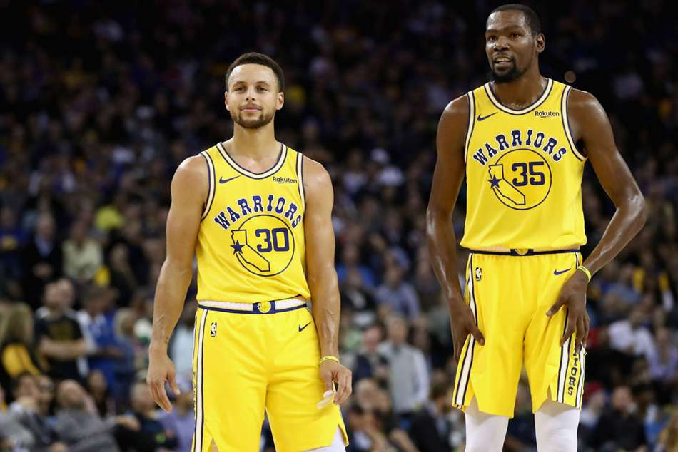 Warriors stars Kevin Durant (right) and Stephen Curry