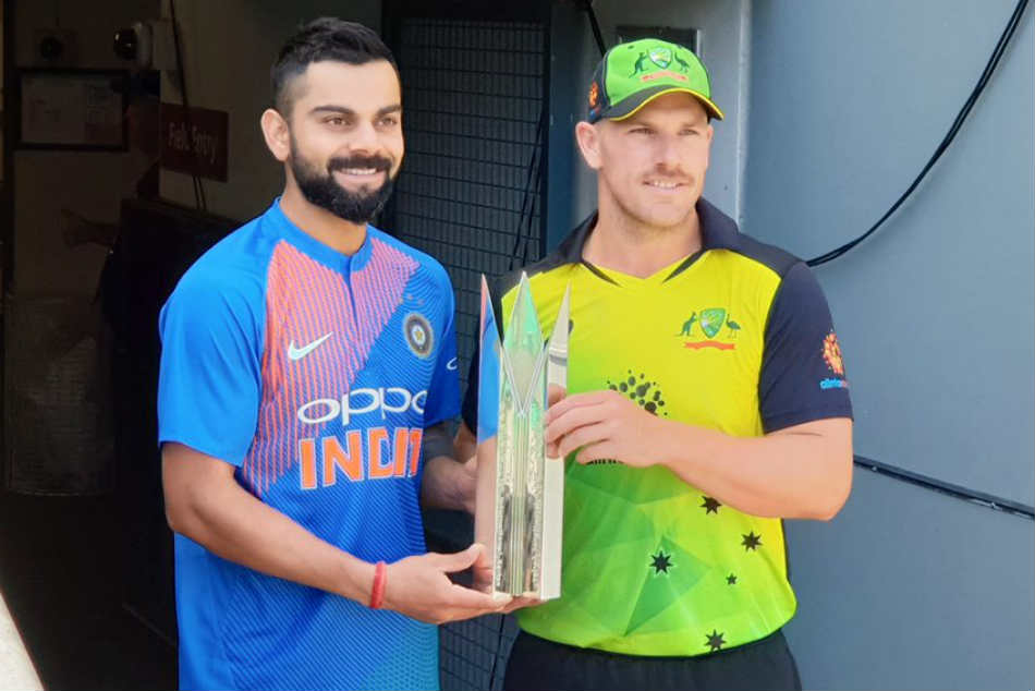 India skipper Virat Kohli and his Australia counterpart Aaron Finch pose with the T20I trophy ahead of the series (Image: BCCI)