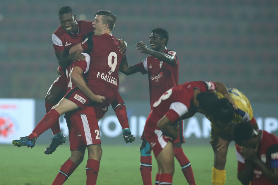 NorthEast United players celebrate the win
