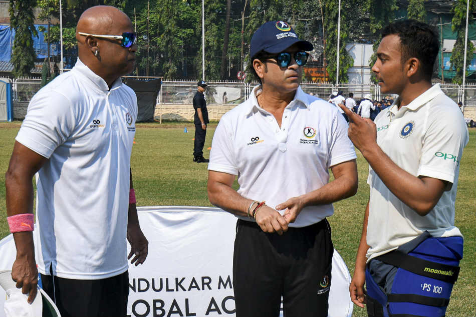 Former Indian cricketers Vinod Kambli and Sachin Tendulkar give tips to young cricketers under Tendulkar Middlesex Global Academy, at the MIG Cricket Club, in Mumbai on Tuesday.