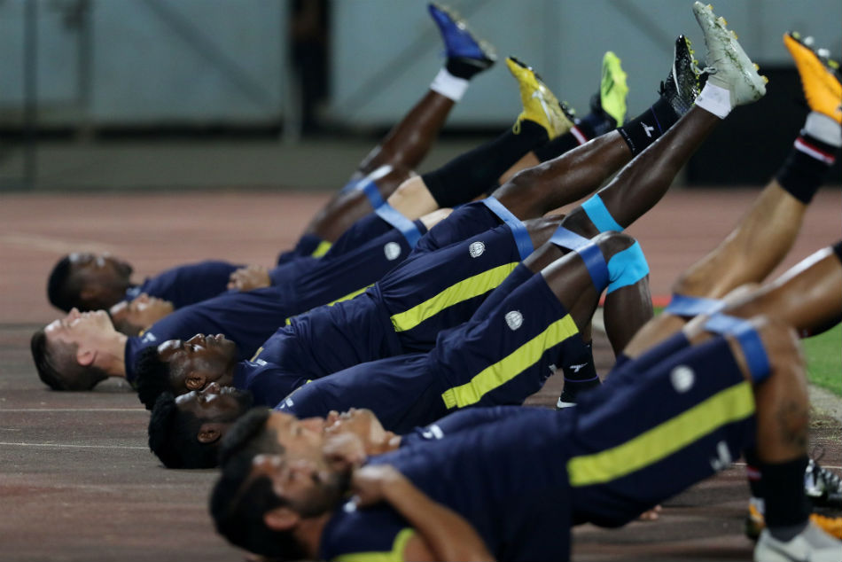 NorthEast United FC players warm up before the start of the match against Jamshedpur FC in ISL. Image: ISL Media