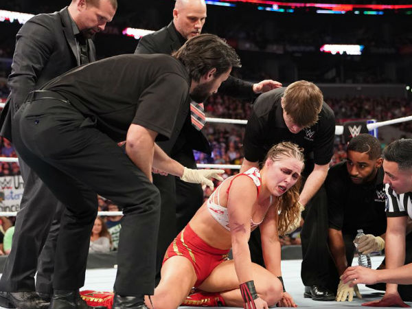 Ronda Rousey assaulted by Charlotte Flair