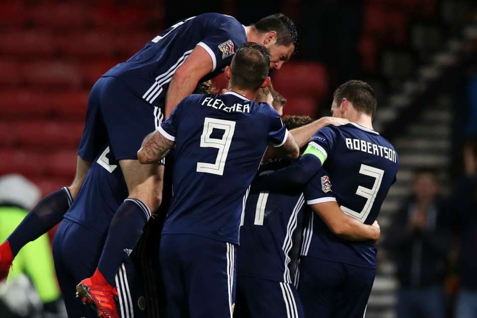 Scotland players celebrate after sealing promotion in UEFA Nations League