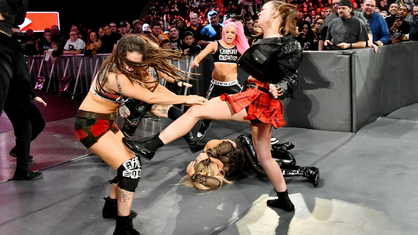 Ronda Rousey (right) fighting the Riott Squad (image courtesy WWE.com)