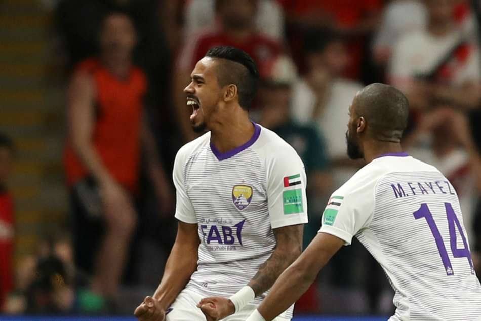 Al Ain players celebrate after shoot-out win