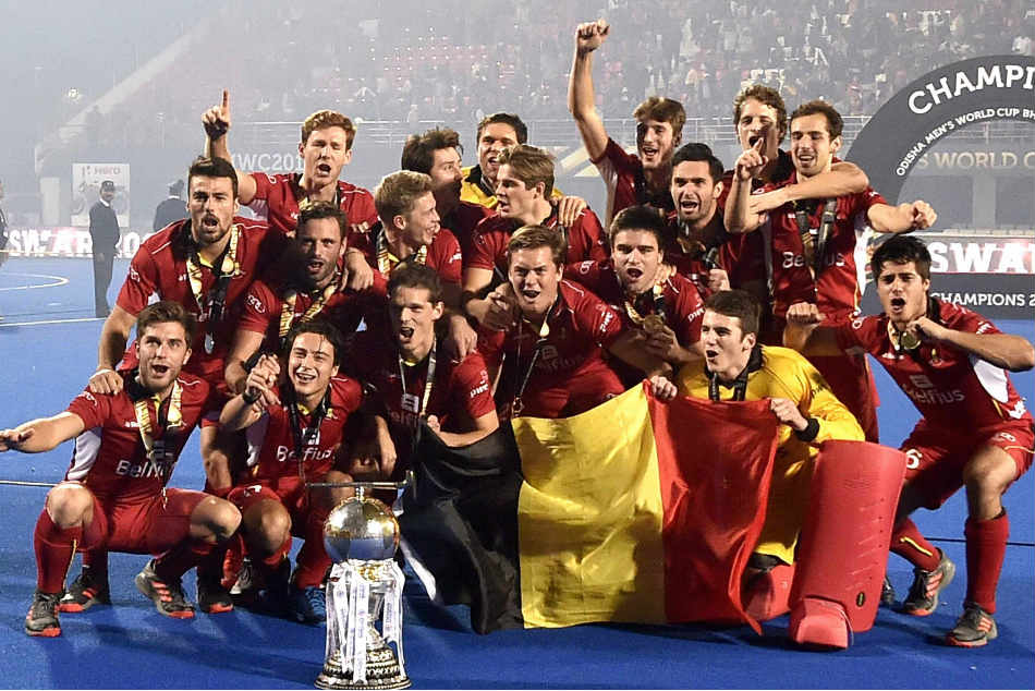 Belgium players celebrate their maiden hockey world cup title