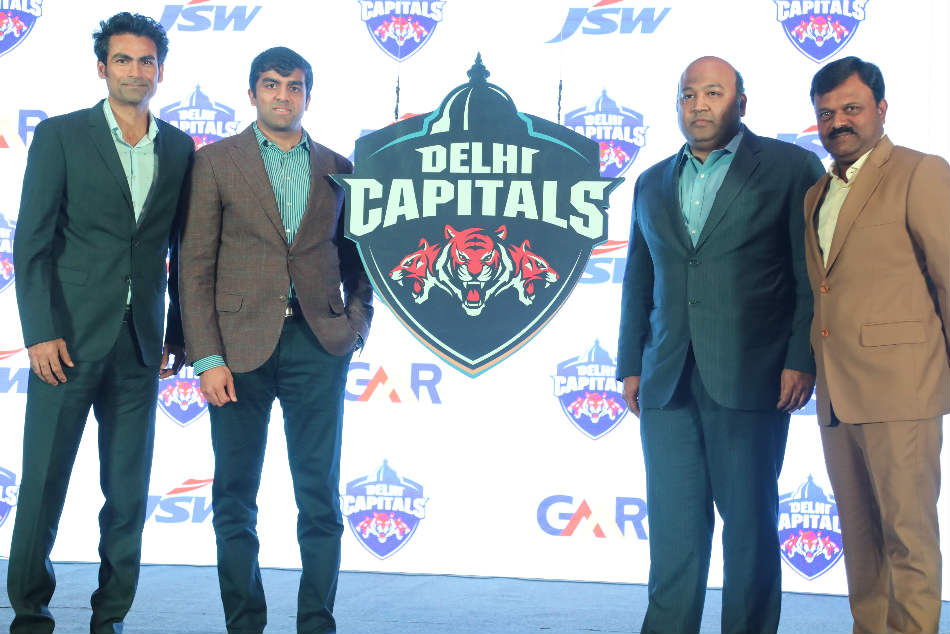 (From Left): Mohammad Kaif, assistant coach, Parth Jindal, chairman and co-owner, Kiran Kumar Grandhi, chairman and co-owner and Pravin Amre, batting coach at the announcement of Delhi Capitals