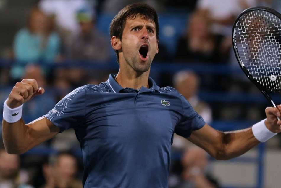 0a9bd363d Novak Djokovic celebrates after winning the World Tennis Championship