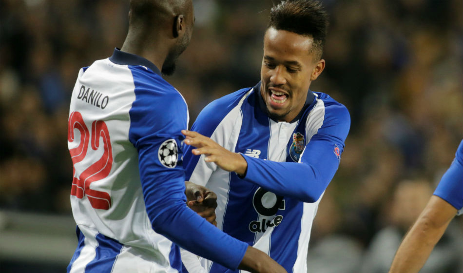 Porto ace Eder Militao (right) linked with Manchester United and Chelsea