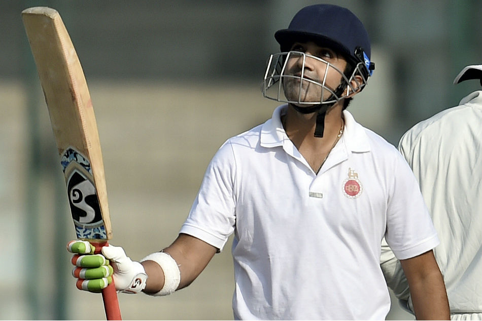 Gautam Gambhir raises his bat after scoring a century during the Ranji Trophy group league match between Delhi and Andhra at Feroz Shah Kotla Ground on Saturday