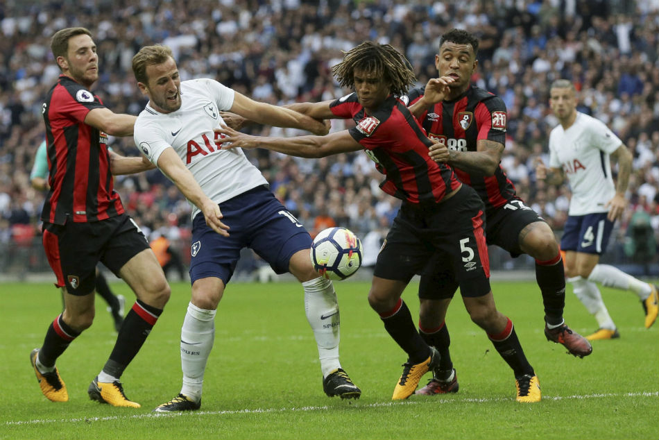 Tottenhams Harry Kane, second left, appeals for a penalty as he competes for the ball.