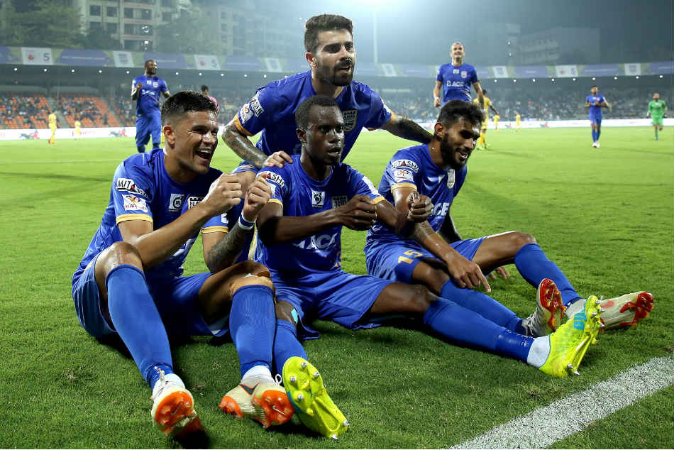 Mumbai City players celebrate a goal against Kerala Blasters. Credit: ISL Media