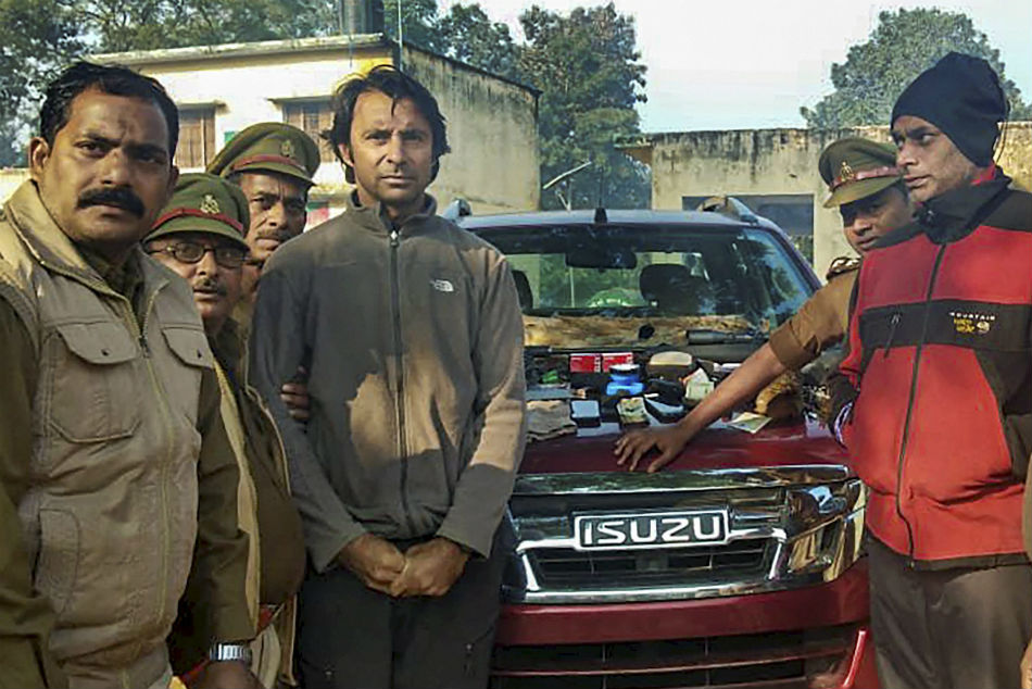 Golfer Jyoti Randhawa (2nd from left) arrested on charges of poaching in the Dudhwa Tiger Reserve protected area, in Bahraich district, December 26.