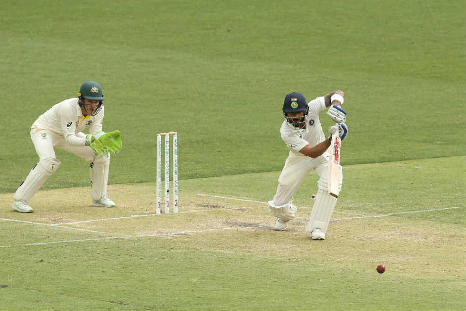 Virat Kohli led Indias fight with a gritty hundred but Australia took a substantial lead