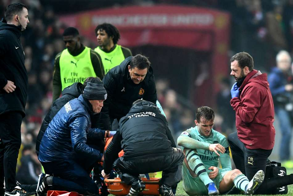 Arsenal defender Rob Holding was stretchered off in the first half
