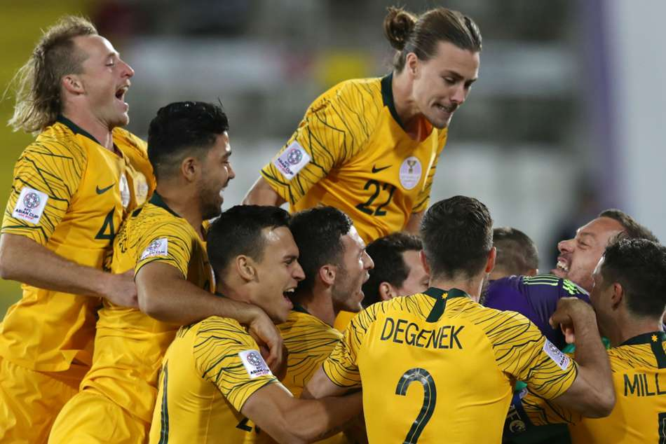 Australia celebrate after the penalty shootout victory over Uzbekistan