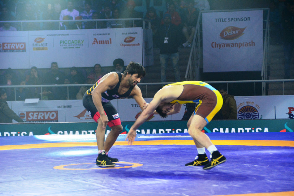 Punjab Royals Bajrang Punia (left) in action against MP Yodhas Haji Aliyev during PWL 4