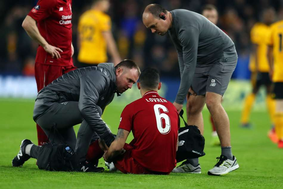 Liverpool defender Dejan Lovren receives treatment