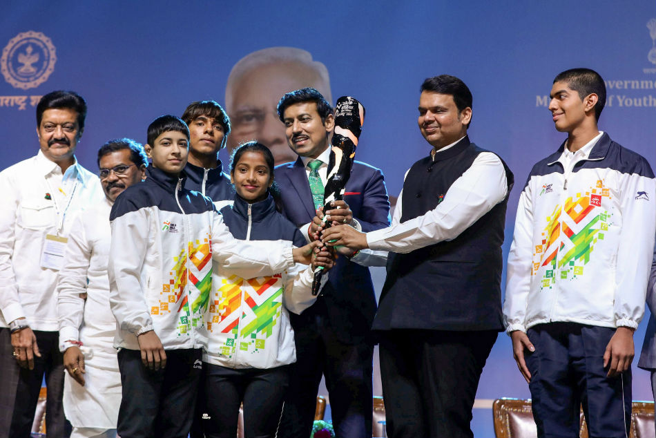Maharashtra Chief Minister Devendra Fadnavis with Union Sports Minister Rajyavardhan Singh Rathore during the opening ceremony of Khelo India Youth Games 2019