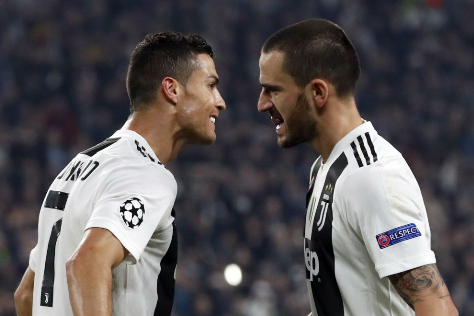 Leonardo Bonucci (right) returned to Juventus after one season at Milan