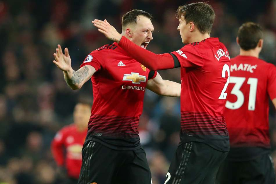 Manchester United defender Phil Jones (left) says the Red Devils are heading in the right direction after Mourinho sacking