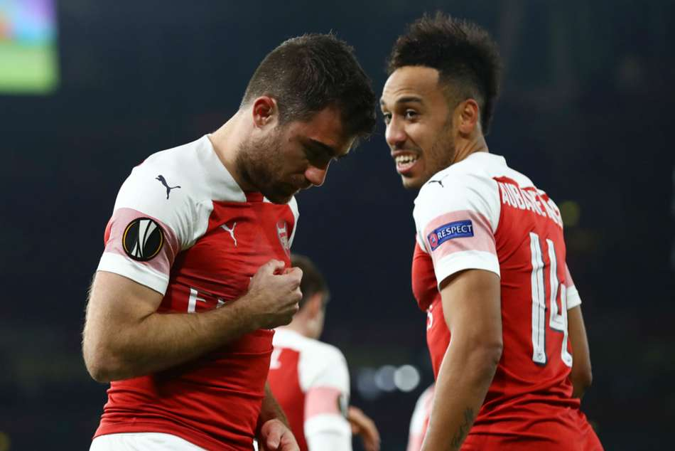 Arsenal goal-scorer Sokratis (left) celebrates with Pierre-Emerick Aubameyang