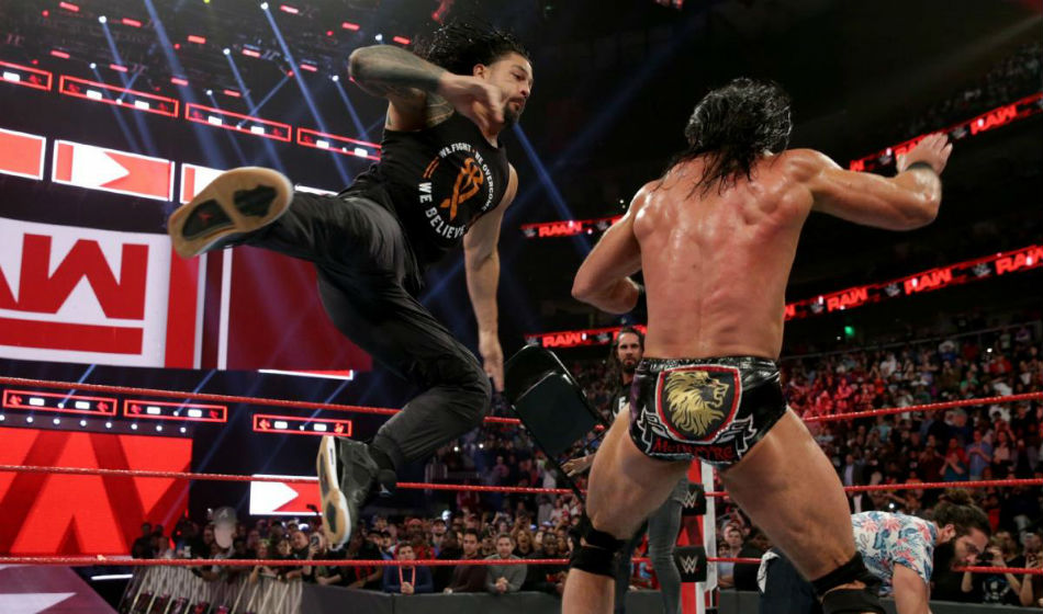 Roman Reigns (left) hits a superman punch on McIntyre during Raw (image courtesy WWE.com)