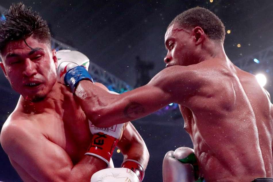 Errol Spence Jr Beats Mikey Garcia Calls Out Manny Pacquiao