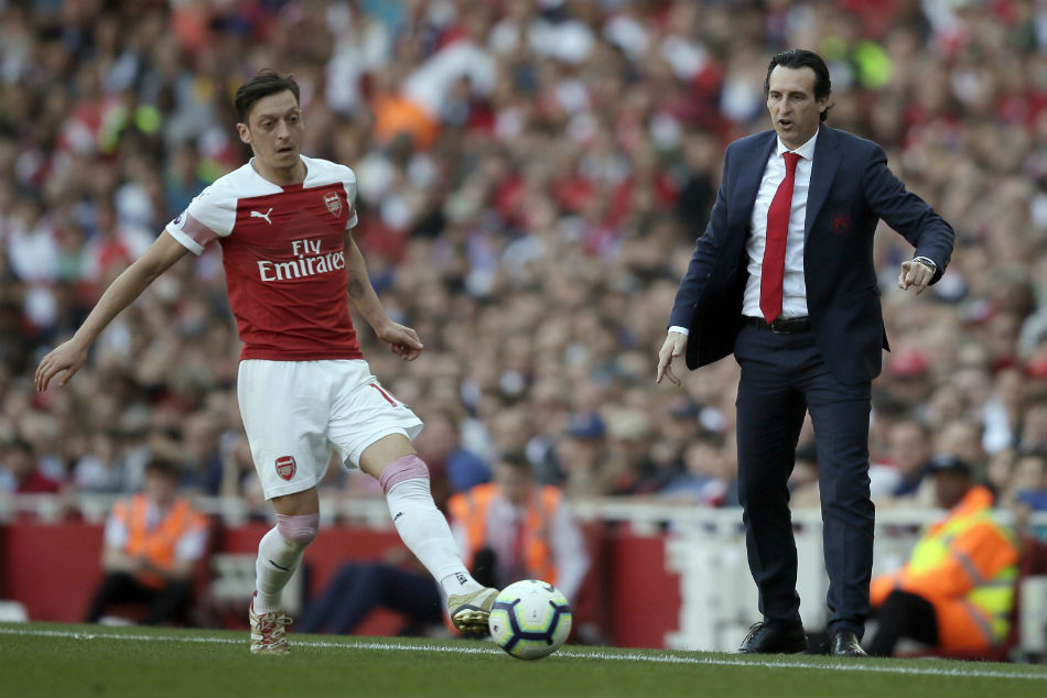 Arsenal boss Unai Emery (right) depends on the defence for top four finish