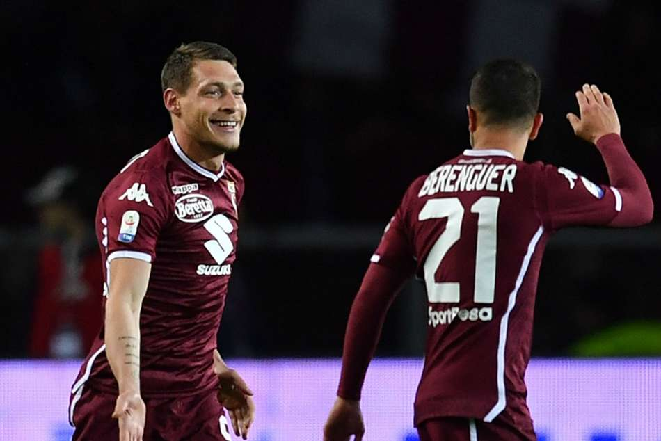 Torinos Andrea Belotti (left) celebrates with teammate after scoring the opener