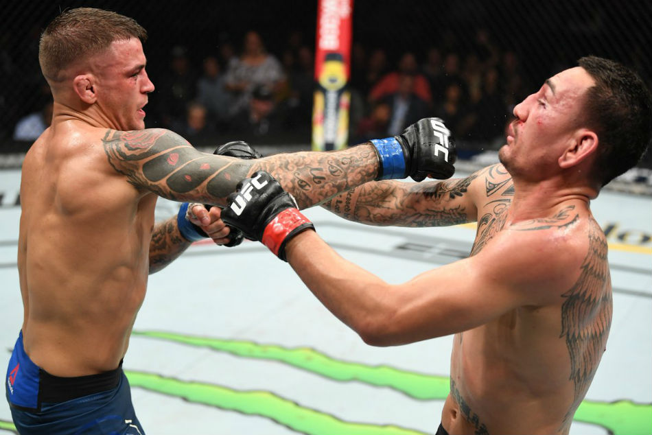 Dustin Poirier (left) outlasted Max Holloway to claim interim lightweight title at UFC 236 (Image Courtesy: Twitter)