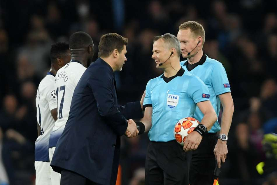 Tottenham head coach Mauricio Pochettino (left) questions match official Bjorn Kuipers after the match