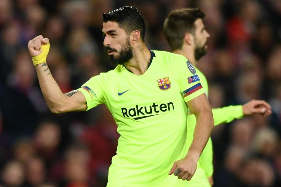 Barcelonas Luis Suarez celebrates after his header was deflected into goal by Manchester Uniteds Luke Shaw
