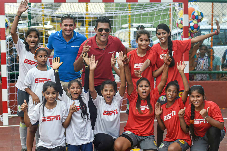 Ajit Agarkar and Daren Ganga during a promotional event at Dharavi in Mumbai on Wednesday