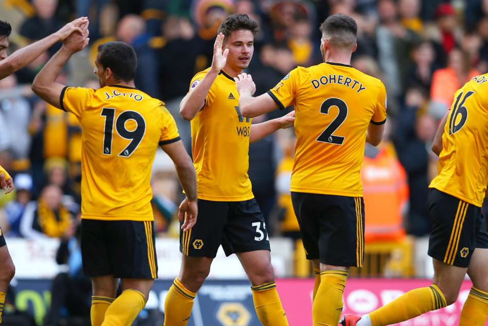 Leander Dendoncker celebrates with teammates after scoring the lone goal in Wolves win